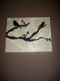 1) rip out pages from an old book and cover with Mod Podge 2) Cover the whole canvas with the pages and a final layer of Mod Podge 3)Let dry 4) Draw branches and leaves on with a permanent marker 5)Print out pictures of of bird, but out and trace on!