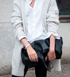 Don't underestimate the statement of a white shirt and black pants with. Fluffy wrap knit