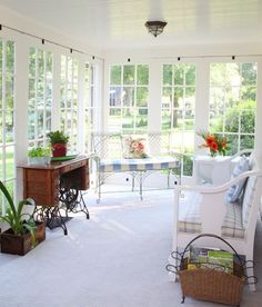 Blue and white sunroom. Link includes 35 Beautiful Sunroom Design Ideas
