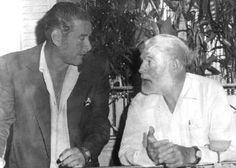 Ernest Hemingway and actor Errol Flynn. Flynn starred in Hemingway's The Sun Also Rises in 1957.