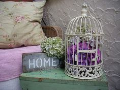 bird cage decorated with hydrangeas.