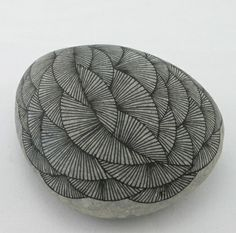 DIY paper weight- take a fine sharpie to a smooth stone