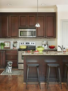 Stylish Condo Living. Backsplash With Dark CabinetsDark Brown Kitchen ...