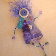Violetta- Whymsies quilted beaded DOLL brooch pin- lavender-turquise-purple and white- Button face- yarn hair via Etsy