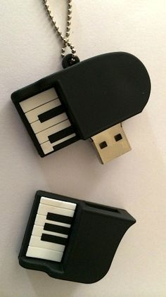 They know me! I feel so understood! :-D <3 the keys logically would need to work :-P Accessoires Iphone, Usb Stick, Piano Music, Piano Keys, Music Stuff, Fun Stuff, Cool Gadgets, Music Lovers, Things To Buy