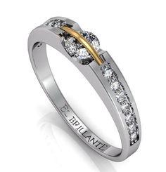 Anillo de compromiso en oro blanco de 18 quilates , diamante central giratorio de 0,30 cts y 14 diamantes de 0,02  www.elbrillantejoyeria.com.co