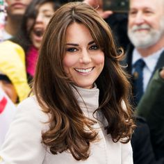 KATE MIDDLETON - 2012 The Duchess debuted side-swept bangs during a visit to the Natural History Museum in London, the shorter layers framing her face and giving her trademark look more dimension.