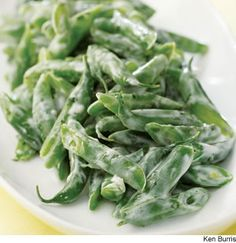 Green Beans With Creamy Garlic Dressing - Inspired by a Lebanese pasta dish, we toss steamed green beans with garlicky yogurt for an easy side dish.