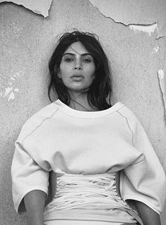 Corset belt on oversized sweater. Kim Kardashian by Lachlan Bailey for Vogue Australia June 2016