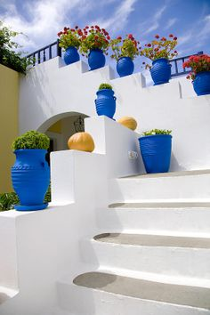 Blue flowerpots with red geraniums line the exterior white stairs in Kos Greek island Kos, Wonderful Places, Beautiful Places, Greek Decor, Greek Blue, Santorini, Mykonos, Greek Islands, Blue Flowers