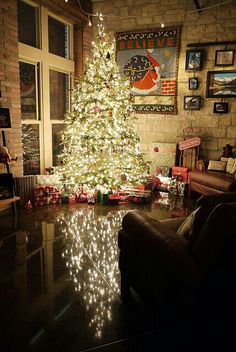 I love shining my floor at Christmas time so my tree has a reflection!!