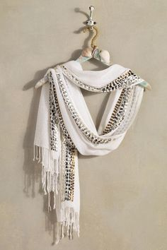 Glistening hand-swen borders bring striking contrast to our Izmir Scarf. Wrap it around your shoulders or neck for endlessly stylish looks.