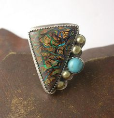 Ring | Laura Pacino. Sterling silver, Koroit Boulder Opal and Turquoise; what a dynamic combo!