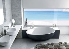 This is a great example of how beautiful modern design can be. Mastella Design Bahia free standing Bathtub is the focus of this room. This can appeal to more that modern design lovers.