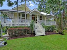 A Beautiful Home know as a Queenslander. As they were designed for the tropical state of Queensland in Australia. Raised to let the breeze circulate under the the home and a gorgeous wrap around veranda. Australian Architecture, Australian Homes, Residential Architecture, Exterior Colors, Exterior Design, Cabana, Brisbane, Porches, Lush