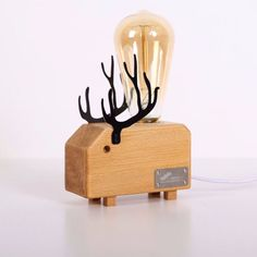 DETAILS - It is always Christmas time with this wooden Deer Night Lamp! - It is a great night light for a cozy atmosphere! - The filaments inside the Edison bulb create a lovely pine tree when you tur