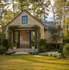 Stone carriage house remodel with french doors