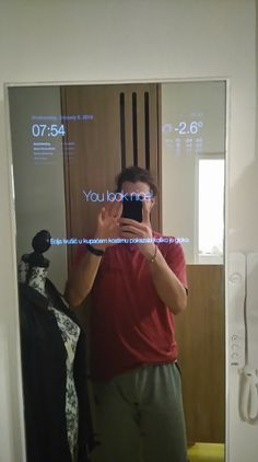 Front side of my mirror with motivational message and hottest news