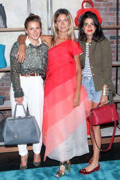 Fendi Soho Pop Up Claire Distenfeld with a Fendi bag, Natalie Joos in Fendi, and Leandra Medine.