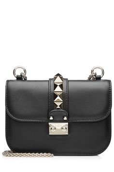 Classic black leather informs this iconic 'Lock' silhouette from Valentino, with glossy Rockstud embellishment for indulgent finesse. The interior promises to room all of your daily essentials Black leather, platinum studs, push-lock fastening front, leather lining, internal zipped pocket Structured silhouette