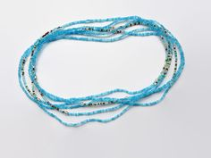 Very long turquoise seed bead necklace. Pritty! https://www.etsy.com/nl/listing/214180178/lange-wikkelketting-aqua-rocailles-sand