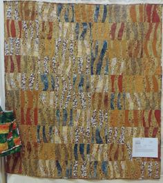 """This quilt is called """"On the Beach"""". If you look closely you will see that there is a pebble print fabric used. It really looks like a beach and the patterns that are created by the waves."""