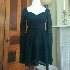 Sale! NWT sweetheart fit & flare dress. Gorgeous Darling little black dress! Sweetheart neckline and low back zipper detail. Skirt is a line and tapers in that waste, long sheer sleeve. Lined and front and on skirt Venice Dresses
