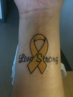 My second tattoo. For my niece, Savannah, who was diagnosed with Retinoblastoma on 06/05/09. It's supposed to be gold for Childhood Cancer Awareness, but it turned out more yellowish because of my skin tone. Font is Murray Hill. Inside of my right wrist. June 2010.