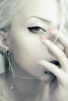 Lip and ear piercing chained together