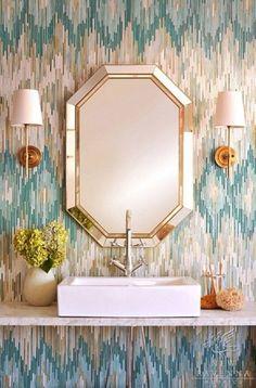 interior design bathroom: brass wall sconces, white sink, Missoni style textured wallpaper, venetian mirror