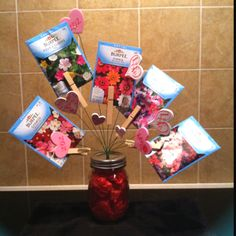 My new Valentine bouquet for my Mom.  Made with wooden clothes pins, flower seed packets and foam hearts hot glued to floral wire picks in tissue paper scrunched into a Kerr jar.  I hope she likes it!
