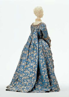 """Robe a la francaise"", also called a saque. This type of gown had a fitted bodiced gown which opened to show the stomacher. It had two large double pleats that hung down the back from shoulder to hemline."