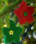 Bright Star Ornament by Coats and Clark and found on All Free Crochet.  I think these would be cute for the tree or for the presents.  I wonder what they would look like in white cotton thread.