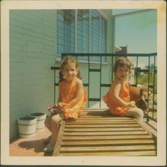 with my little sister in suriname (south america). my mother dressed us alike for years. we're wearing tights in the tropics.