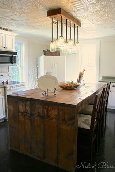 I will be building an island like this. Maybe a stainless top since my counters are already wood.