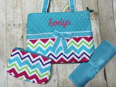 A personal favorite from my Etsy shop https://www.etsy.com/listing/265761884/monogrammed-diaper-bag-3-piece-set