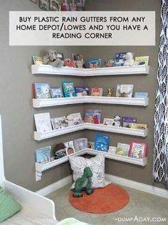Plastic rain gutters used as corner book shelves.