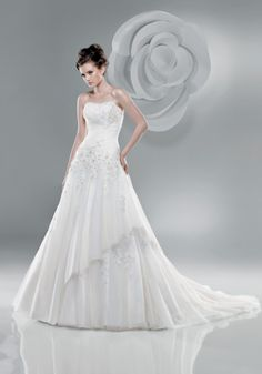 I would do the bodice in satin with maybe an applique or two... top skirt chiffon and then bottom skirt layer in lace.