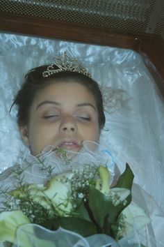 Andreea Brazovan in her open casket during her funeral.