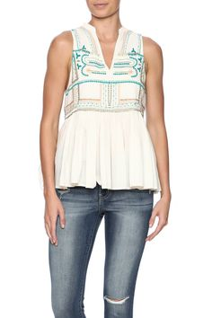 Cut-in tank top with gathered peplum, featuring embroidery and beaded detail.   Nantucket Embroidered Tank by Chloe Oliver. Clothing - Tops - Sleeveless Clothing - Tops - Blouses & Shirts Long Island, New York