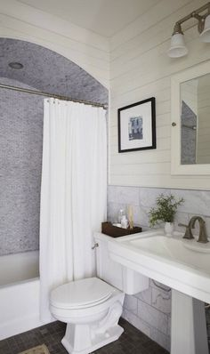 Tracery Interiors - Gorgeous bathroom with glossy white pedestal sink, marble subway ...