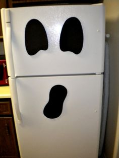 ghost fridge - such a cute idea (and tons of other cute Halloween ideas)