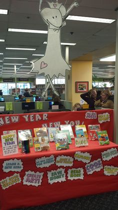 """Interactive New Years Resolutions book display! I covered the display table in different goals, like """"Be nice to my brother or sister"""", """"Save money"""", """"Learn a new skill"""", and """"Clean my room"""", and invited kids to 'vote' by putting a star sticker on the thing that they are most excited to do in 2015. Then I stocked the display with Juvenile Nonfiction titles for all the different resolutions, like art books and cookbooks."""