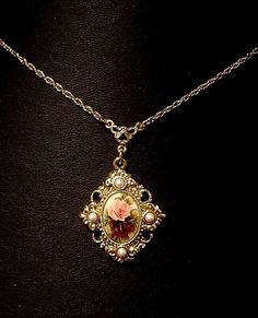 If I had one of these, I would SOOOOO wear it! Vintage Necklace 1928 Jewelry Co Roses and by VintageTreasures