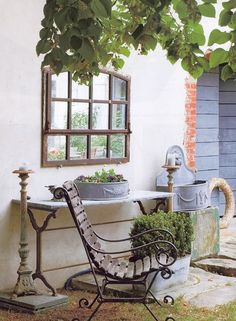 Rustic Gardens: A Feast for the Senses. Zinc containers, an old mirror, a vintage chair