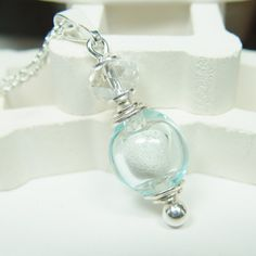 PRECIOUS- by Clearly Loved - Hollow Glass Cremation Urn Necklace - Pale Aqua Transparent Oval