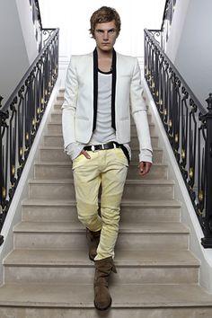 white jacket, black lapels. boots.