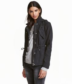 Black. Parka in washed cotton twill with a stand-up collar and drawstring hood…