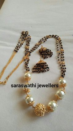 Black beads for kids Gold Mangalsutra Designs, Gold Earrings Designs, Gold Jewellery Design, Bead Jewellery, India Jewelry, Gold Jewelry, Beaded Jewelry, Gold Necklace, Jewelry Patterns