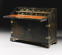 A Chinese black lacquer bureau mid 18th century